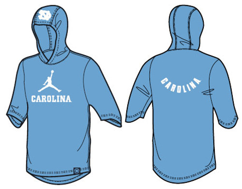Carolina Blue hooded short sleeve tee shirt with Jumpman logo on the front and Carolina in a reverse arc on the back. There is an interlock NC on the hood.