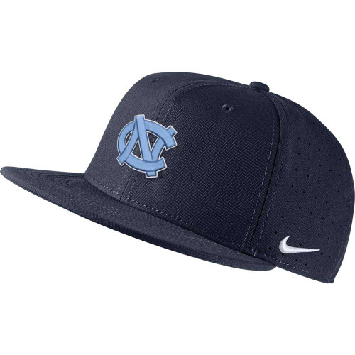 Flatbill fitted hat that is solid navy.  It has an embroidered interlock NC on the front.