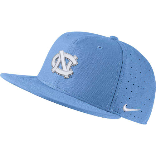 Flatbill fitted hat that is solid Carolina Blue.  It has an embroidered interlock NC on the front.