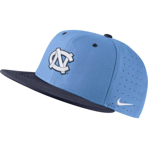 Flatbill fitted hat that has a navy bill and a Carolina Blue crown.  It has an embroidered interlock NC on the front.