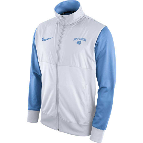 Track jacket where the body is white and the set in sleevees are Carolina Blue.  The left chest has North Carolina over an interlocked NC and the right chest has the Nike swoosh.  The back has big bold letters North Carolina.