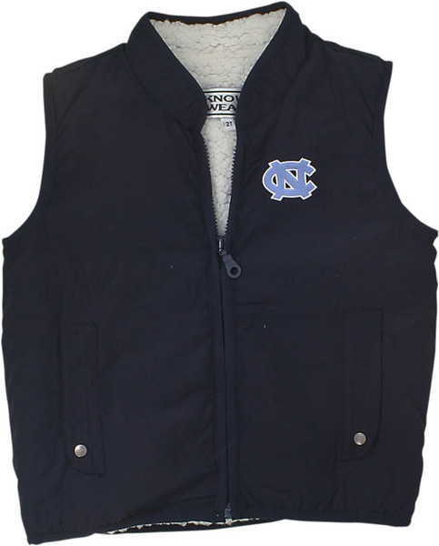 navy vest with crme fuzzy insides and an interlocking NC