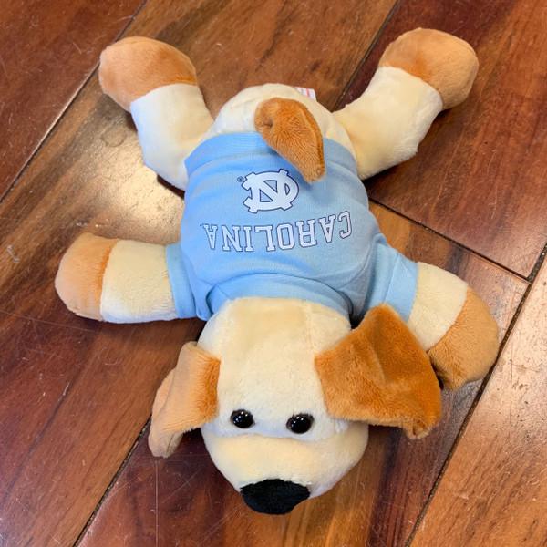 stuffed floppy puppy wearing a Carolina tee shirt