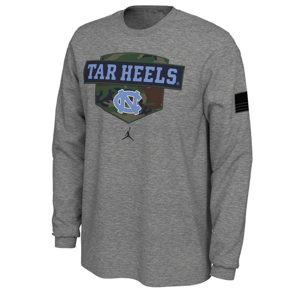 Gray long sleeve tee with camo shield design that has the lettering Tar Heels and interlocking NC.  Sleeve has an American Flag.