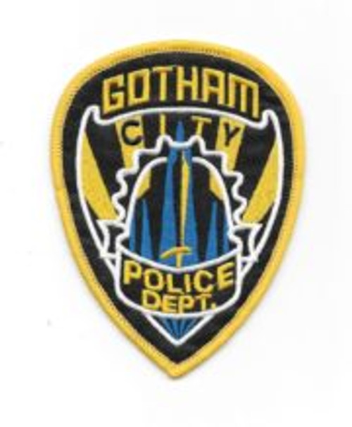 Batman gotham police dept shield logo embroidered patch This is the logo of the Gotham City Police Department as seen in the movie Batman Forever. This patch measures 3.5″ x 4.5″ and is in mint condition.  It has been stored in a smoke and pet free environment and comes with a glue backing for easy application to a cloth surface.