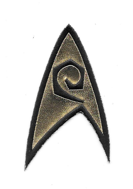 Star Trek Classic TV Series Engineering Logo Embroidered Chest Patch NEW UNUSED This mint embroidered patch pictures the engineering chevron as seen on the episodes of the original classic Star Trek TV series. It was seen on the left breast of the shirts, as worn by Lt. Uhura and Scotty. It measures 3.5″ high and was originally made by Majel Barrett Roddenberry's company and have always been difficult to find outside of Star Trek conventions.