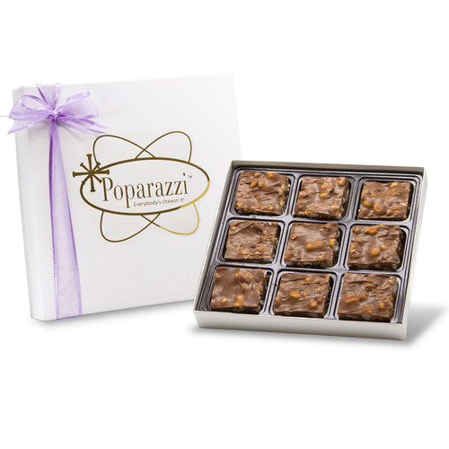 Milk Chocolate Poparazzi - 9 pieces of milk chocolate covered popcorn candy with caramel in a white box with a purple ribbon