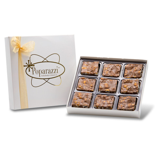 Milk Chocolate Poparazzi - 9 pieces of milk chocolate covered popcorn candy with caramel in a white box with a gold ribbon