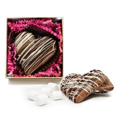 Heart shaped hot chocolate bomb made with Milk Chocolate, Chocolate Powder, and Mini Marshmallows.