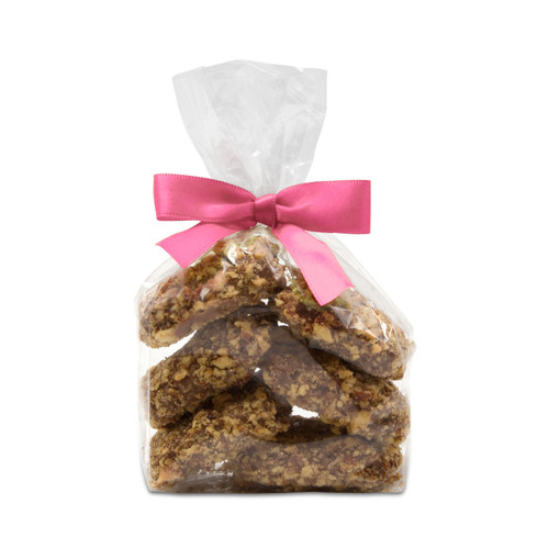 Award-winning Toffarazzi toffee in a small chocolate gift bag with a light pink bow perfect for springtime or Mother's Day chocolate gifts