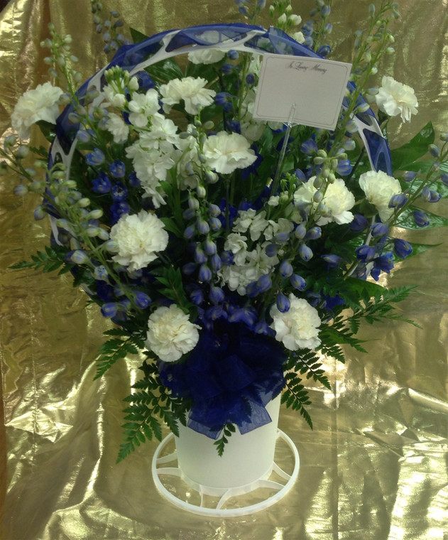 Sympathy basket carnations/delphinium