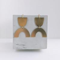 Voyage brass arch earrings