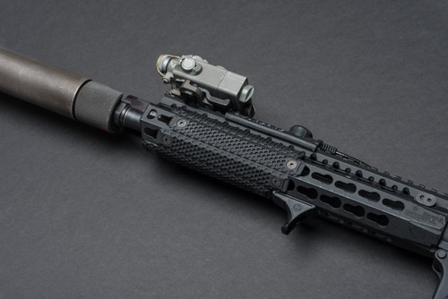 Our namesake RailScales rail cover scale in mini-dot on an AR-15 forend with a suppressor and Steiner DBAL laser