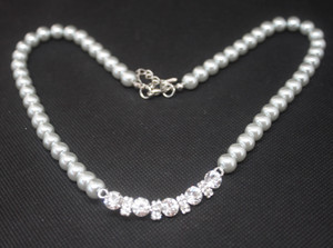 Grey pearl necklace with diamante detail.