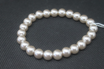 A simple pink pearl like stretch bracelet