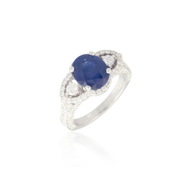 Vintage Sapphire Ring with Mingled Diamond Halos