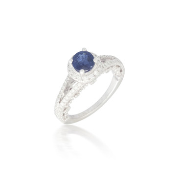 Vintage-style Round Sapphire Ring with Diamond Halo