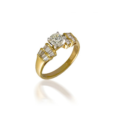 Round Engagement Ring with Fanned Baguette Detail