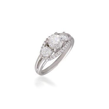 Three Stone Engagement Ring with Adorning Halo