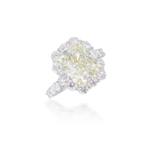 Radiant Yellow Diamond Ring with Diamond Halo