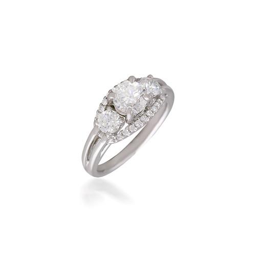 Three Stone Engagement Ring with Adorning Halo