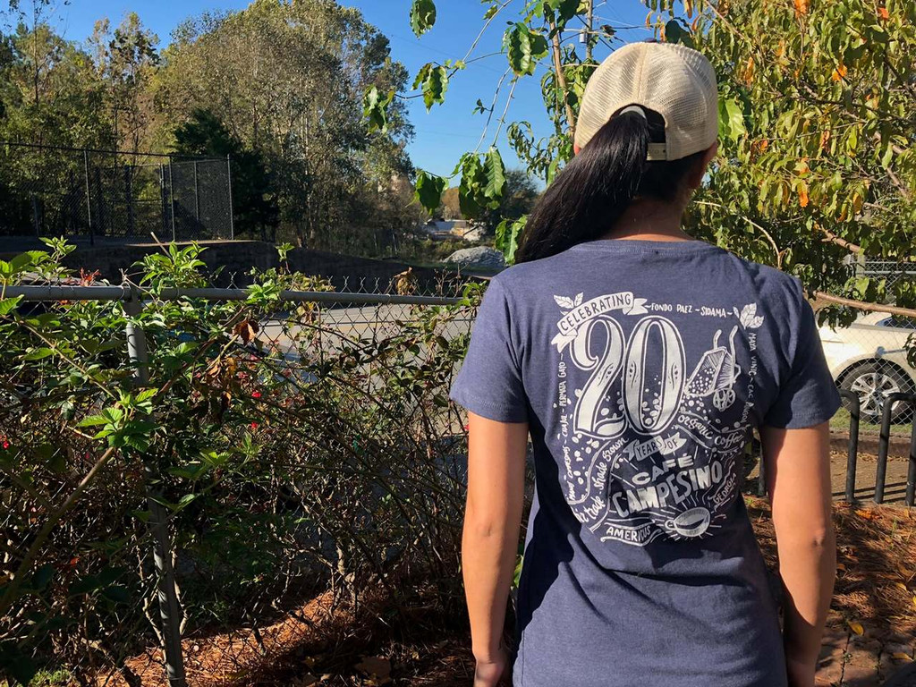 Fitted woman's shirt back with Cafe Campesino's 20th anniversary design by Ann Karp