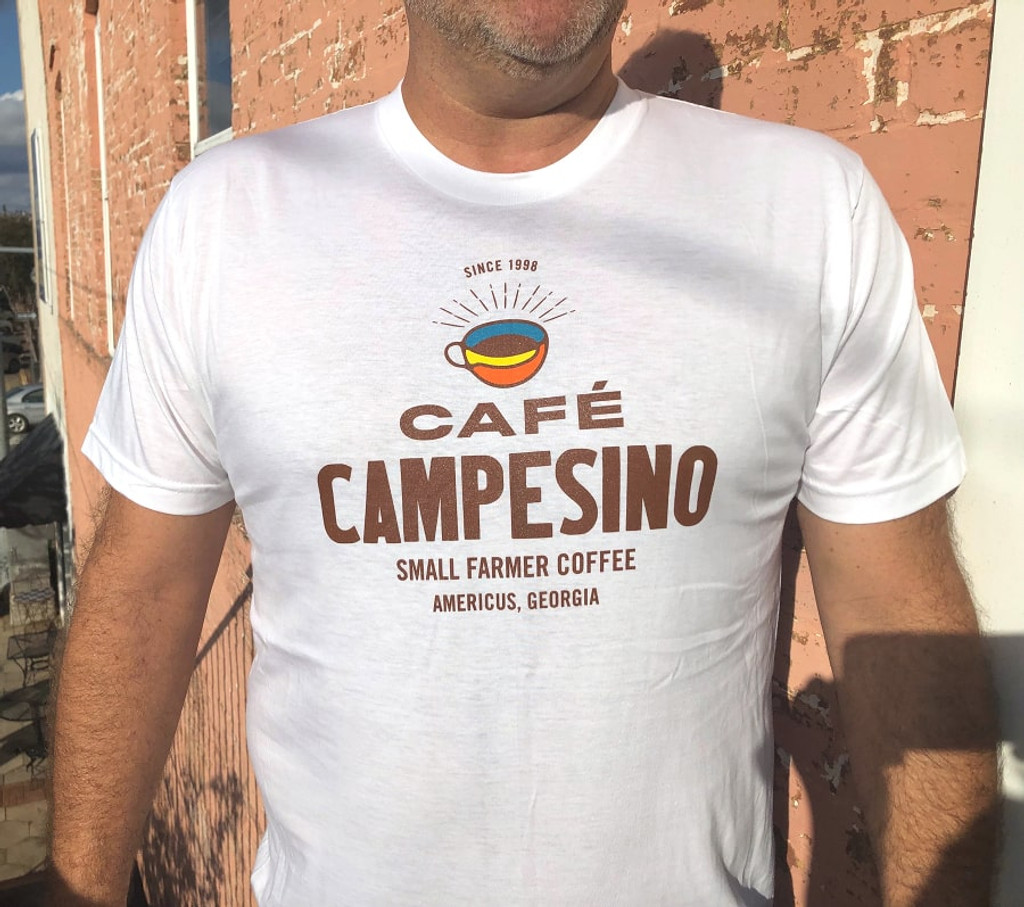 White short-sleeve tshirt made in the USA and bearing the Cafe Campesino logo on the front.