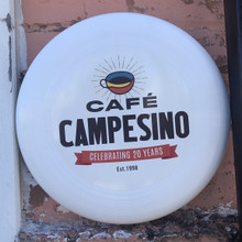 White 175 gram Ultra-star Professional Sportsdisc with 20th Anniversary Cafe Campesino logo.