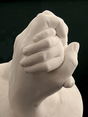 This is a casting of a mom holding her daughter's hand. She loved it.