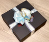 Speciality Gift Boxes with a Blue Ribbon