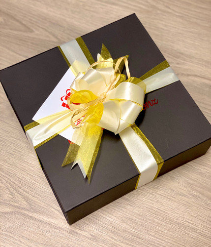 Speciality Gift Boxes with a Yellow Ribbon