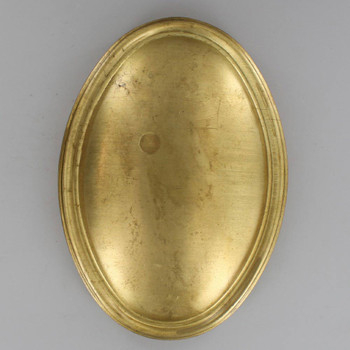 6-3/4 Oval Stamped Backplate with No Holes - Unfinished Brass