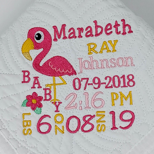 Personalized Birth Announcement Quilt with flamingo has babys birth ststa embroidered on the quilt