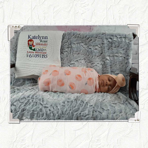 personalized baby quilt with birth information embroidered on the front with a Mermaid