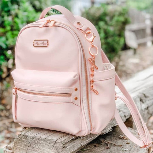 Mini Itzy Ritzy Blush Colored Diaper Bag for little girls
