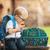 Lifestyle photo of little boys dinosaur duffle bag by Stephen Joseph