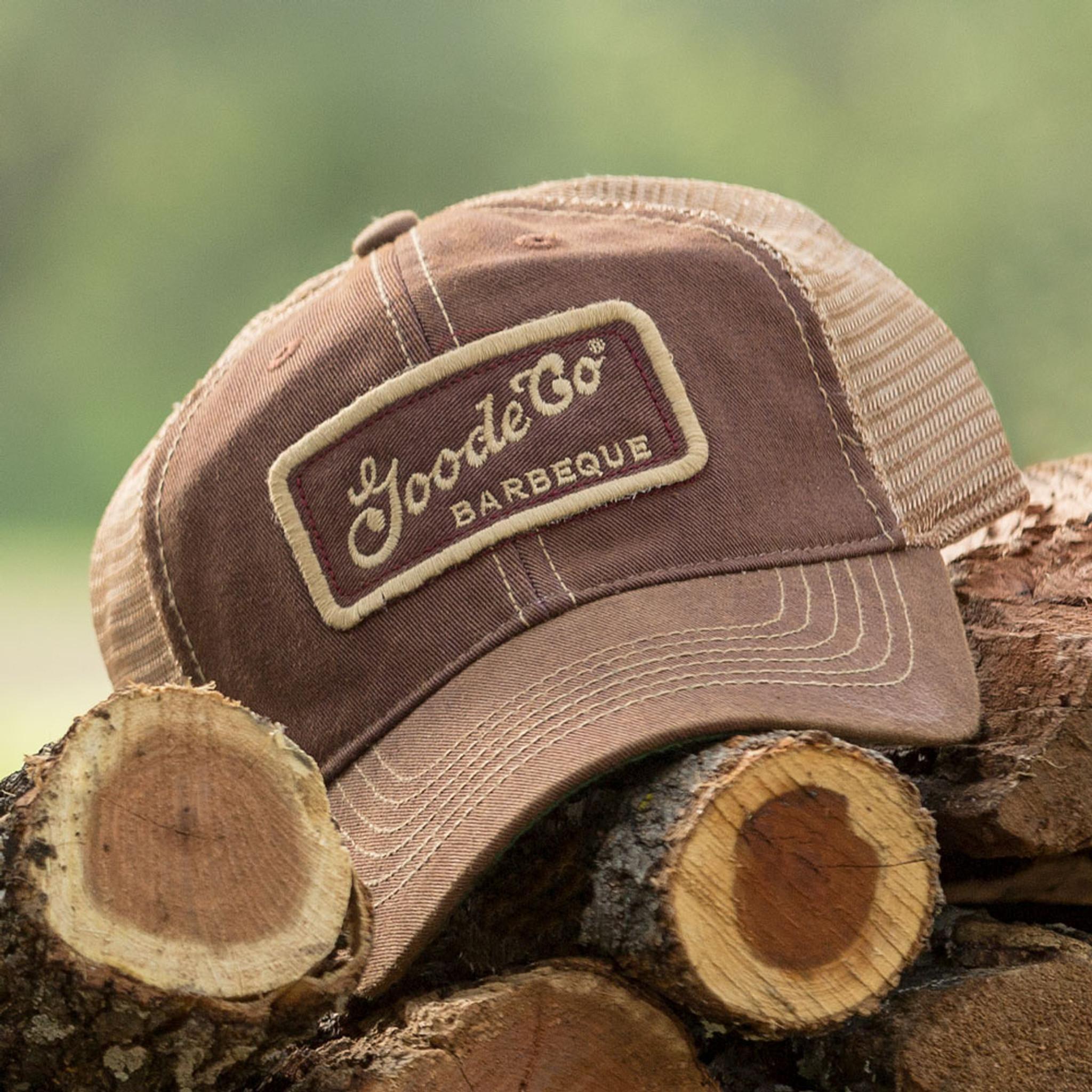 Goode Co's vintage-looking burgundy trucker hat resting on Texas mesquite wood.