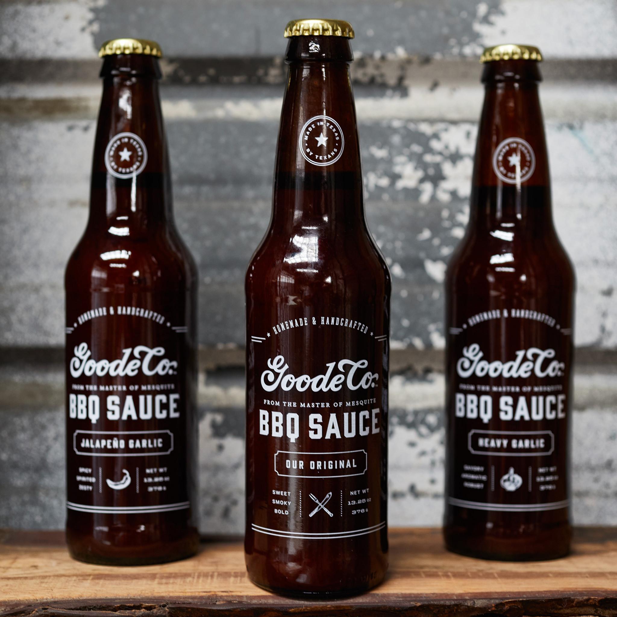3 bottle set of Goode Co's 13.5-ounce longneck beer bottle of Original, Jalapeño, and Heavy Garlic BBQ sauces.