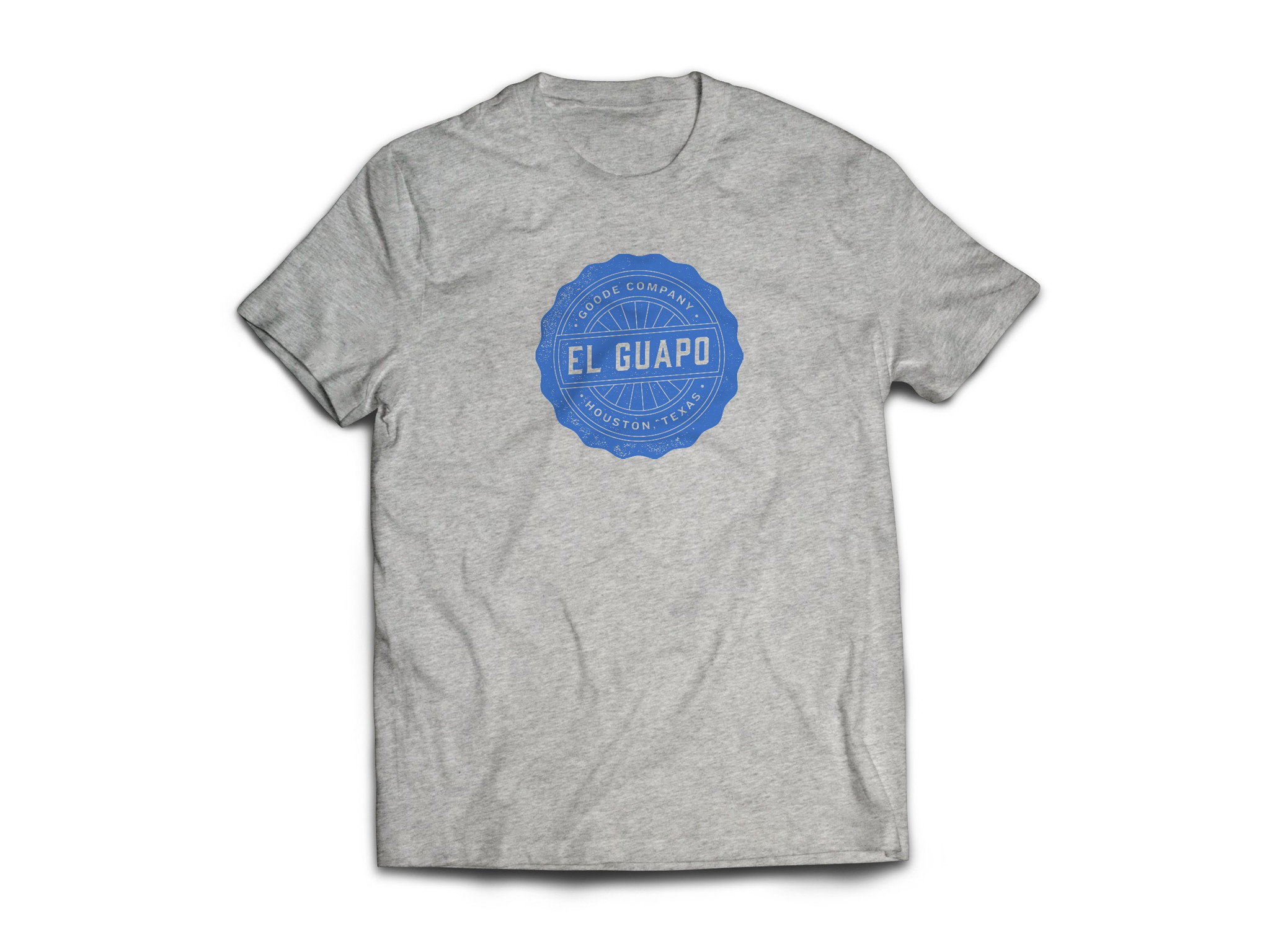 """Proud Texan wearing Goode Co's grey cotton t-shirt that says """"El Guapo"""" in blue font."""
