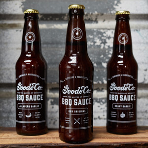 3 bottle set of Goode Co's 13.5-ounce longneck beer bottle of Original, Jalapeño, and Heavy Garlic BBQ sauces.