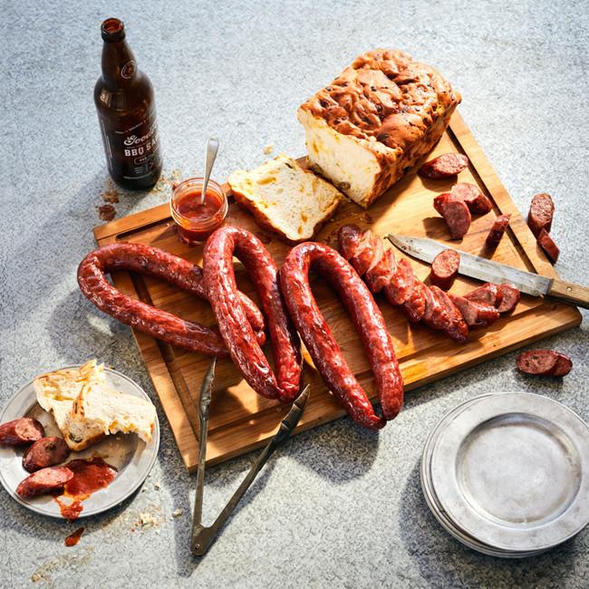 Goode's Sausage Sampler, containing Czech and Jalapeño Pork Sausage, BBQ Sauce, and Jalapeño Cheese Bread.