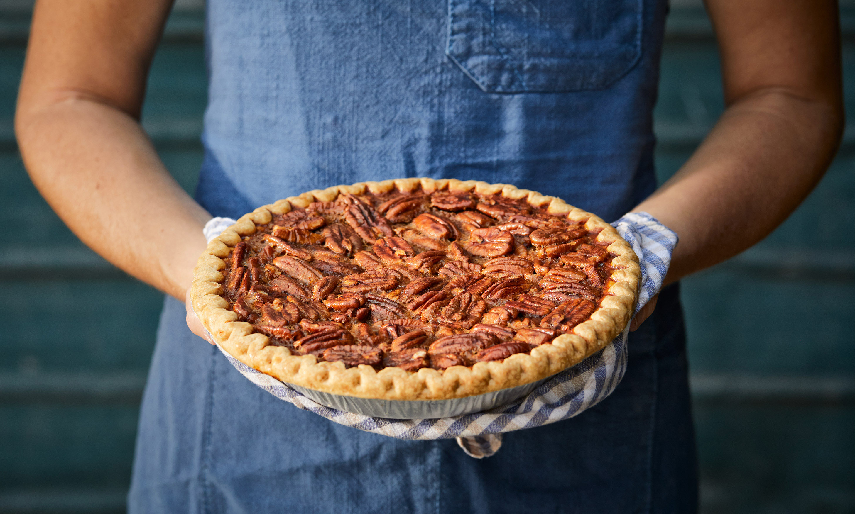 Person holding a pecan pie