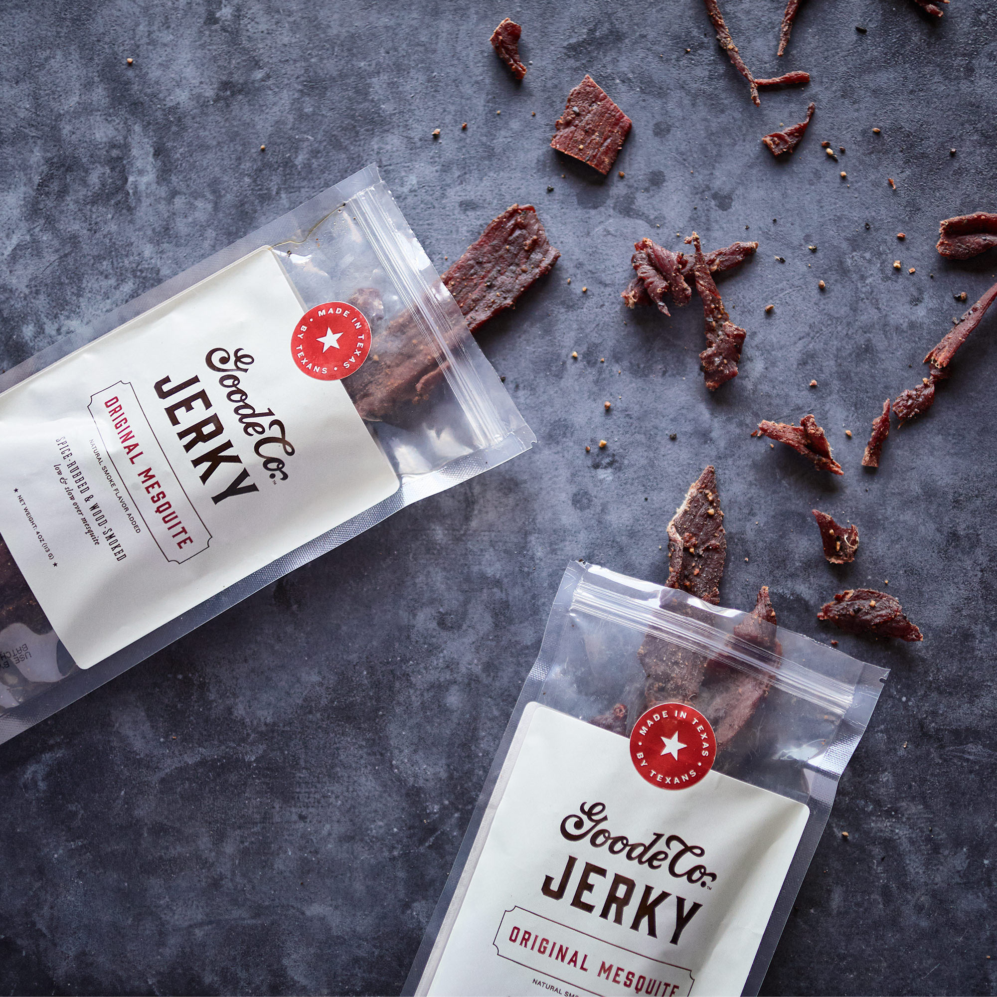 Two bags of Goode Co. Jerky spilling out