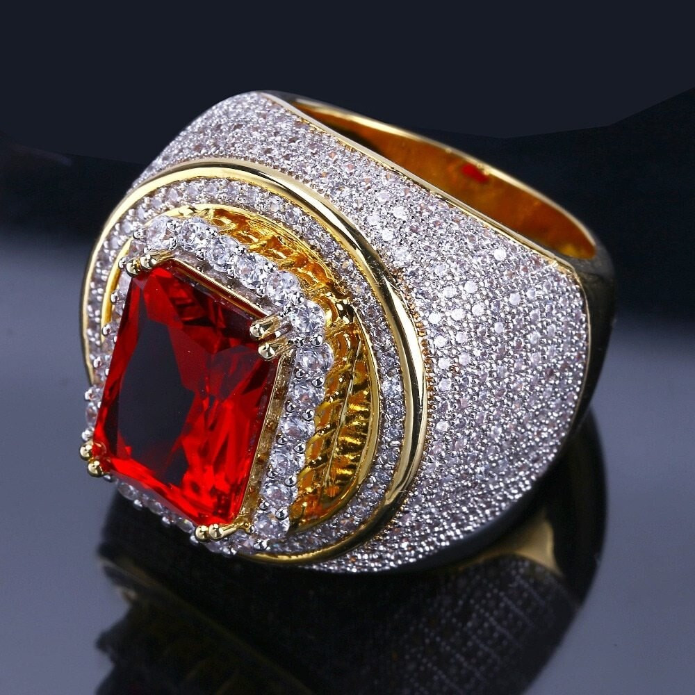 Add Buzz To The Bling With The Reddest Ruby Ring Encased In Glittering Lab Diamonds!