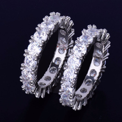.925 Silver AAA Flooded Ice  4mm 1 row Solitaire Rings