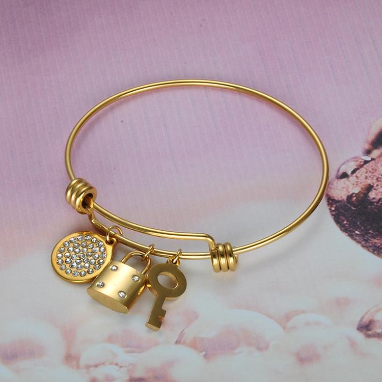 Ladies 14k Gold Simulated Diamond Key Lock Stainless Steel Lucky Bangle Bracelet