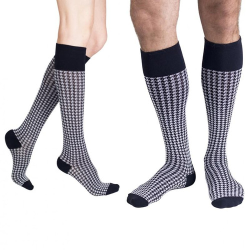 Subtle & sophisticated, this houndstooth is a busy travelers must! Wear from business class straight into the boardroom No one will know they're also renewing your legs with compression. Featuring an off-black base topped with an off-white pattern. From the RejuvaSocks® by RejuvaHealth® Collection.