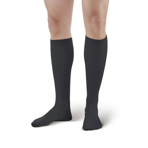 Look sharp in these fashionable pinstripe support socks. Our most comfortable, most elegant sock ever, offered exclusively from Ames Walker! This sock is knitted from a blend of ultra-soft microfiber nylon, with smooth cotton-covered spandex on the inside. Cool and comfortable, with a subtle pinstripe pattern in a complementary color to add a bit of distinct elegance. Comfort and style at a great low price!