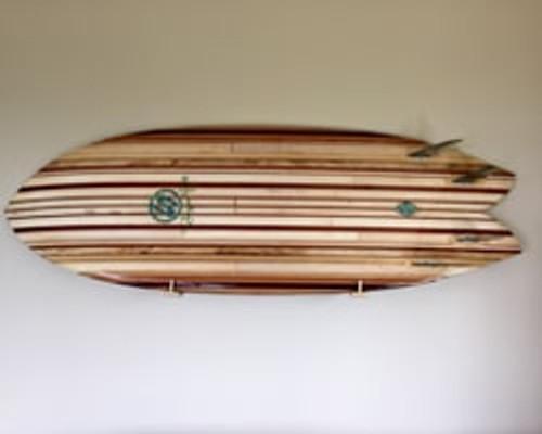 Wooden surfboard on stylish surfboard wall rack