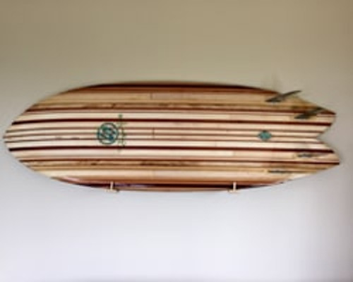 Wooden surfboard on stylish surfboard wall rack